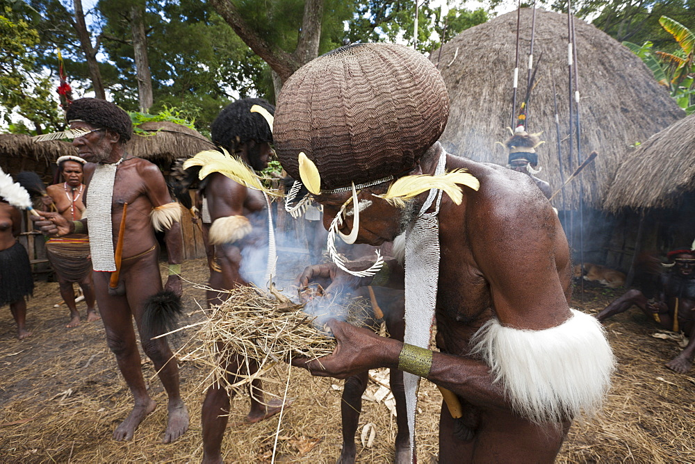 Dani man making fire the old way, Baliem Valley, West Papua, Indonesia, Southeast Asia, Asia - 759-9275
