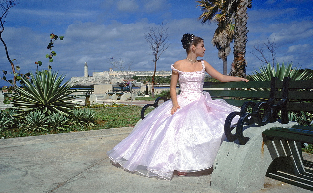 A Quinceanera a young girl having her portrait taken as part of celebrating her fifteenth (Quince Anos) birthday, Havana, Cuba