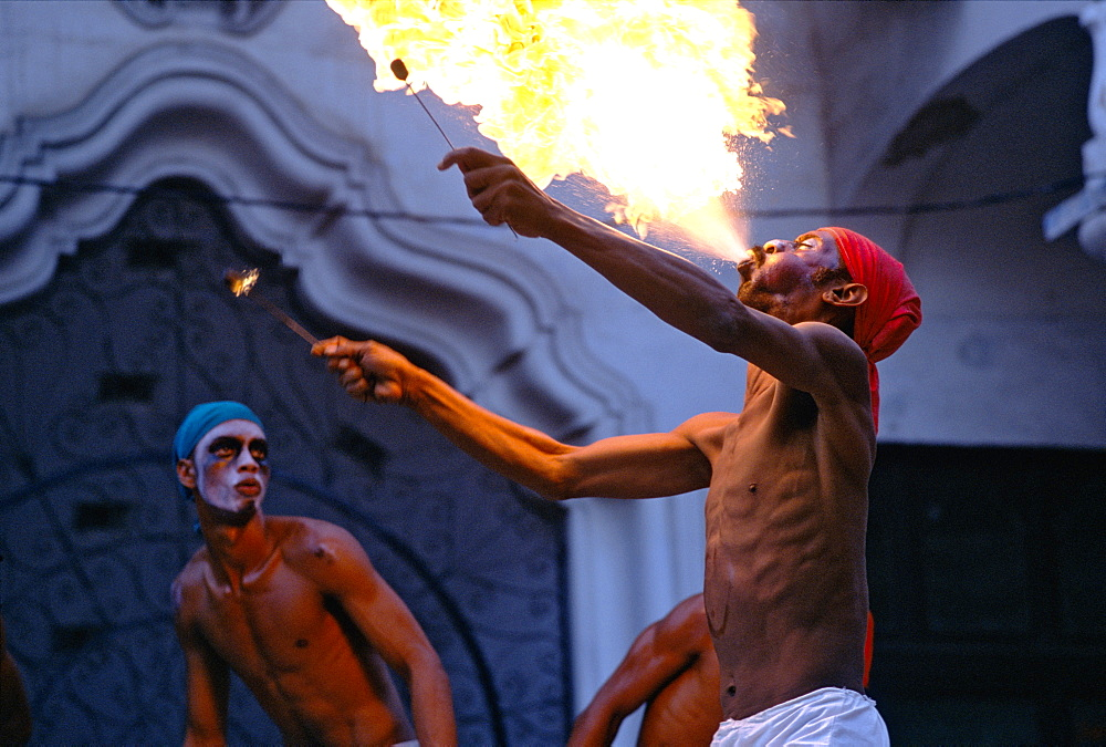 An Afro-Cuban dancer spitting fire at a festival of Afro-Cuban Culture in Guanabacoa just east of Havana, Cuba - 763-110