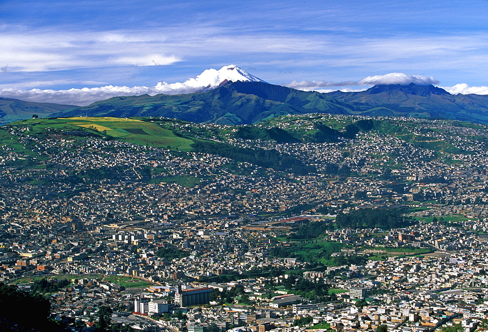 Ecuador's capital and second largest city a view of Quito with Cotopaxi, at 5900 meters, 19,350ft the world's highest active volcano, Quito, Ecuador
