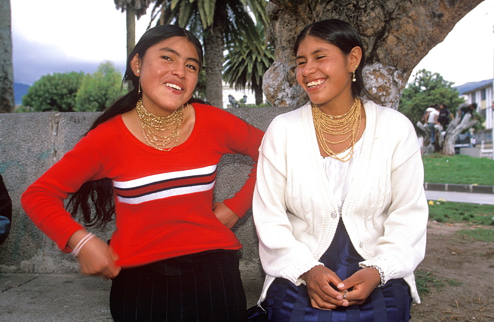 Teenage students on the main plaza of Otavalo, a town famous for its colorful craft and produce market, North of Quito, Highlands, Ecuador