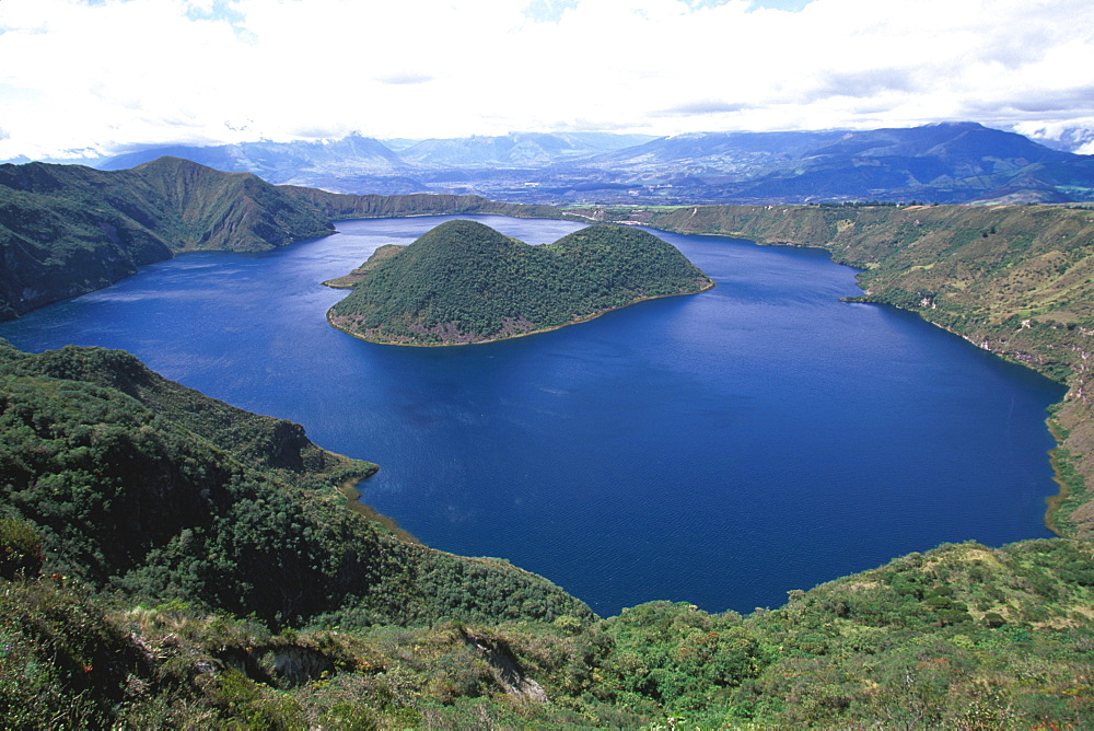 Laguna Cuicocha nestles in the crater of an extinct volcano above the town of Cotacachi and an easy excursion north of Otavalo, North of Quito, Highlands, Ecuador