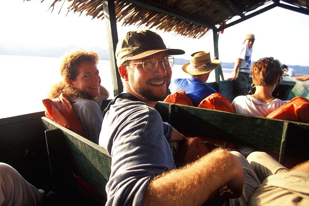 Amazon Basin, Napo River (tributary) La Selva Jungle Lodge, visitors traveling to lodge by motorized dugout canoe, Amazon, Ecuador