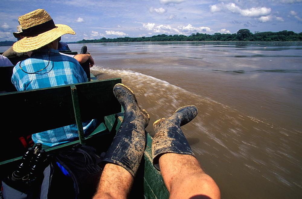 Amazon Basin, Napo River (tributary) La Selva Jungle Lodge, naturalists in dugout canoe on the Napo passing through rainforest, Amazon, Ecuador