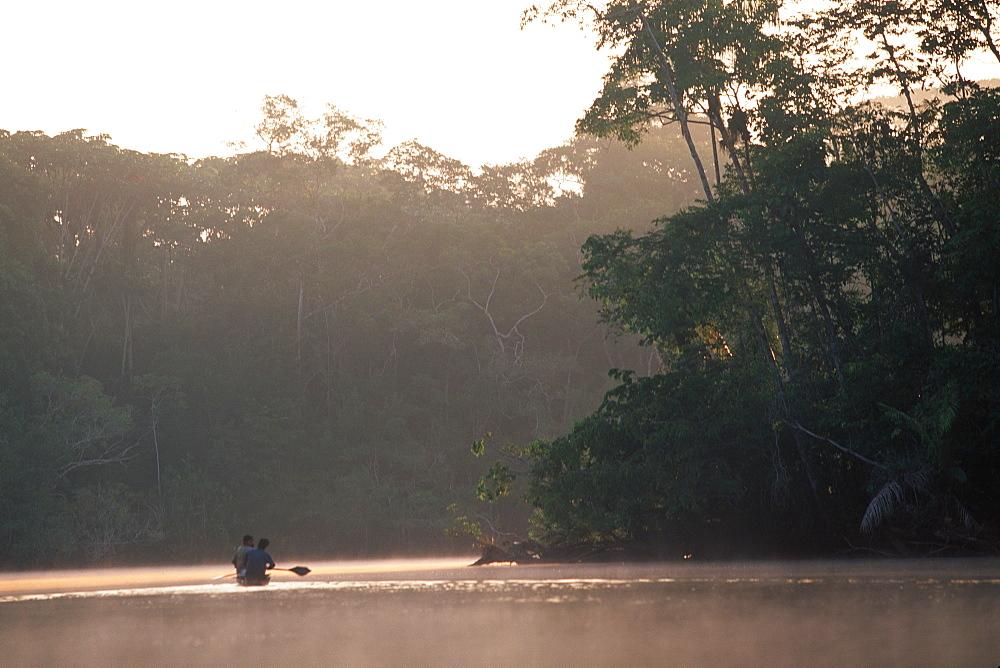 Amazon River Basin Napo River (Amazon tributary) down river from Coca indian in dugout canoe in primary, uncut jungle rainforest, Oriente, Ecuador