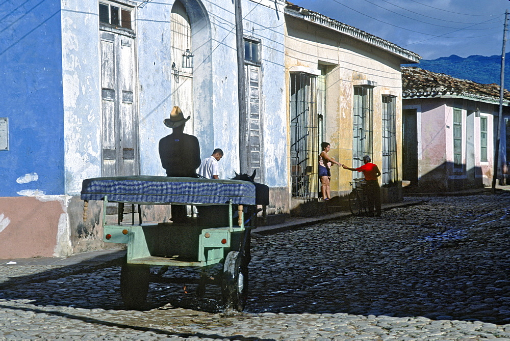 Horse cart (frequently used transportation because of gas shortage) on street in town of Trinidad in Sancti Spiritus Province, Trinidad, Cuba