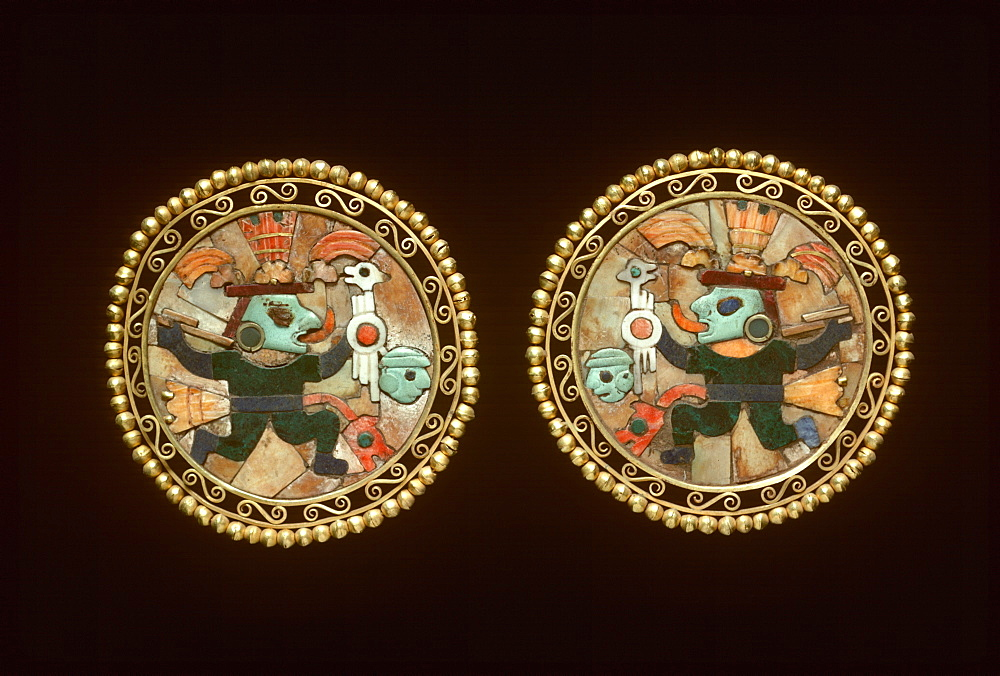 Precolumbian Gold Chimu Culture, 1000-1400AD ear ornaments of gold, lapiz and turquoise shows warrior with victim's head Museo del Oro, Lima, Peru