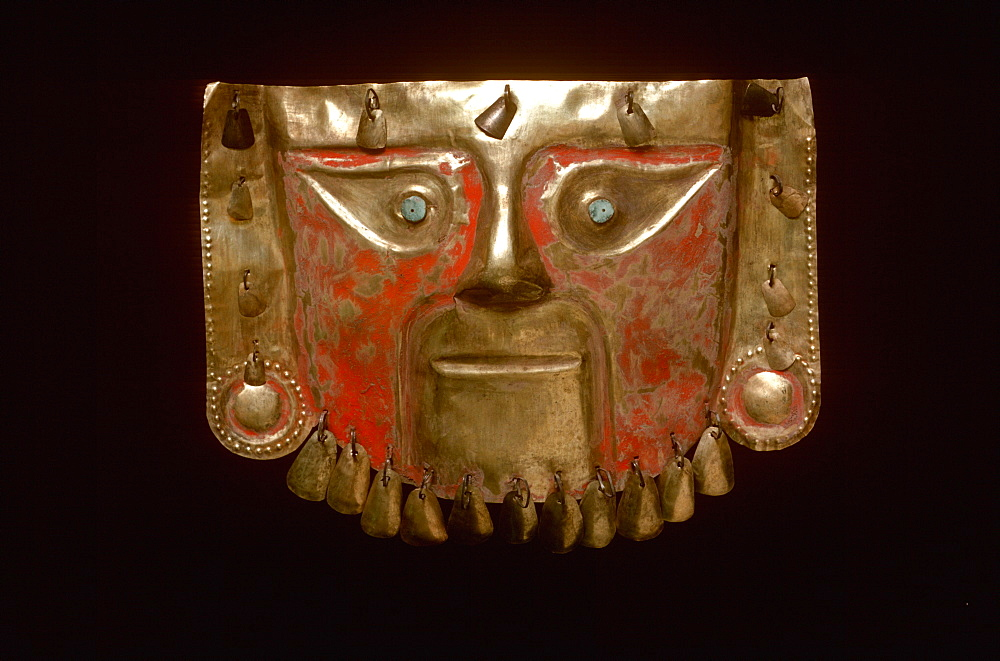 Precolumbian Gold Chimu Culture, 1000-1400AD mask with feline features in gold, turquoise and cinnabar paint collection of Museo del Oro, Lima, Peru