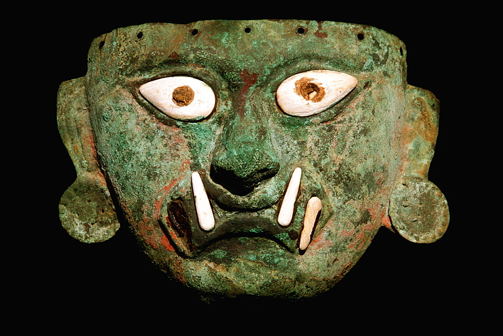 Mochica Culture, 200-800AD, Classic Period supreme feline deity mask in copper and bone Museo Rafael Herrera collection, Lima, Peru