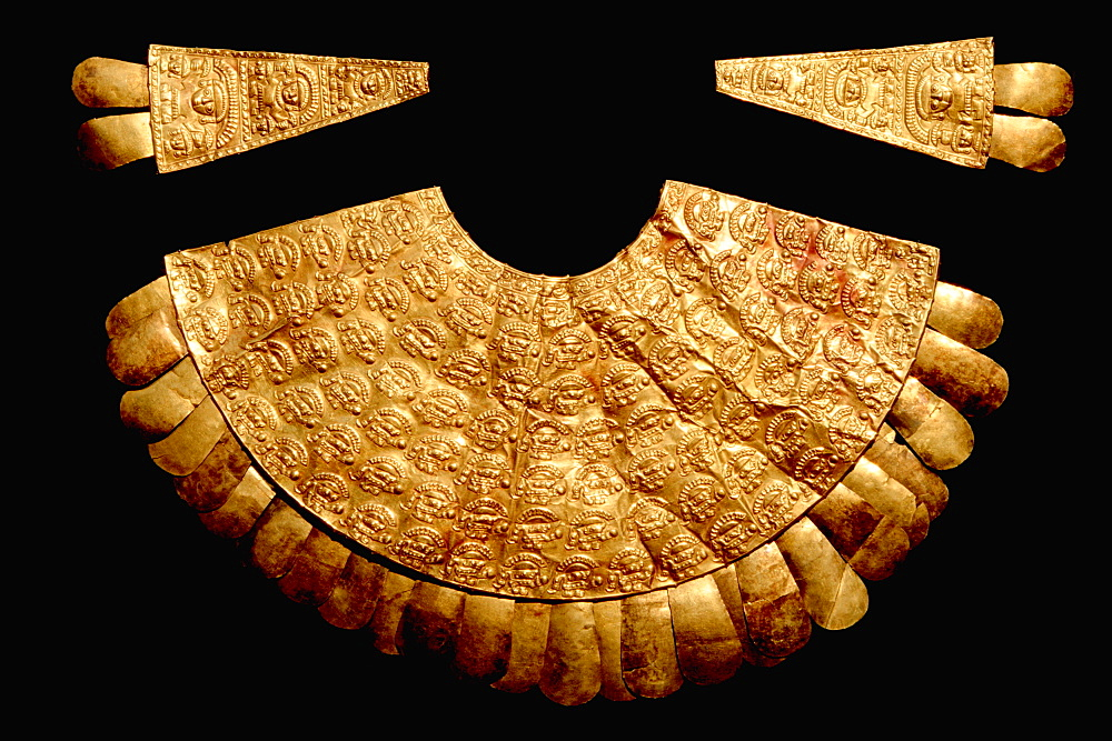 Gold Artifacts Chimu Culture, 1000-1400AD NCoast gold breastplate (pectoral) and two epaulets in the Rafael Herrera Museum, Lima, Peru