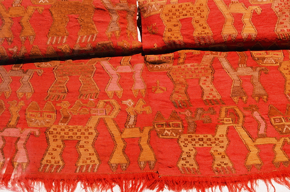 Artifacts from the Chancay Culture, 1100-1400AD, north coast textile with repeating feline and bird designs Museum of the Nation in Lima, Peru