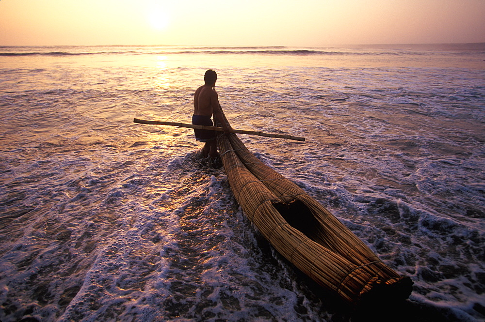 Caballitos de totora', small fishing boats woven of totora reeds in a style unchanged since pre-Inca times at Huanchaco beach, Trujillo, North Coast, Peru - 763-683