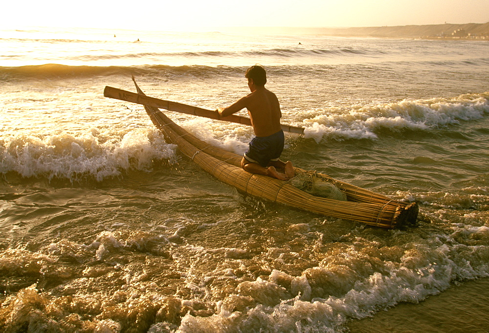 Caballitos de totora', small fishing boats woven of totora reeds in a style unchanged since pre-Inca times at Huanchaco beach, Trujillo, North Coast, Peru