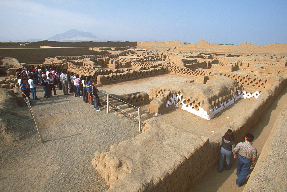 Chimu Culture Chan Chan, 1300-1468AD, capital of empire and world's largest adobe city covering 20 sqkm near Trujillo students in Palacio Tschuldi, Peru