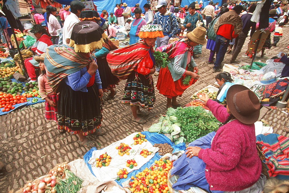 Pisac Village in the Valley of the Incas Sunday Market, one of the world's most colorful craft and produce markets, Cuzco area, Highlands, Peru