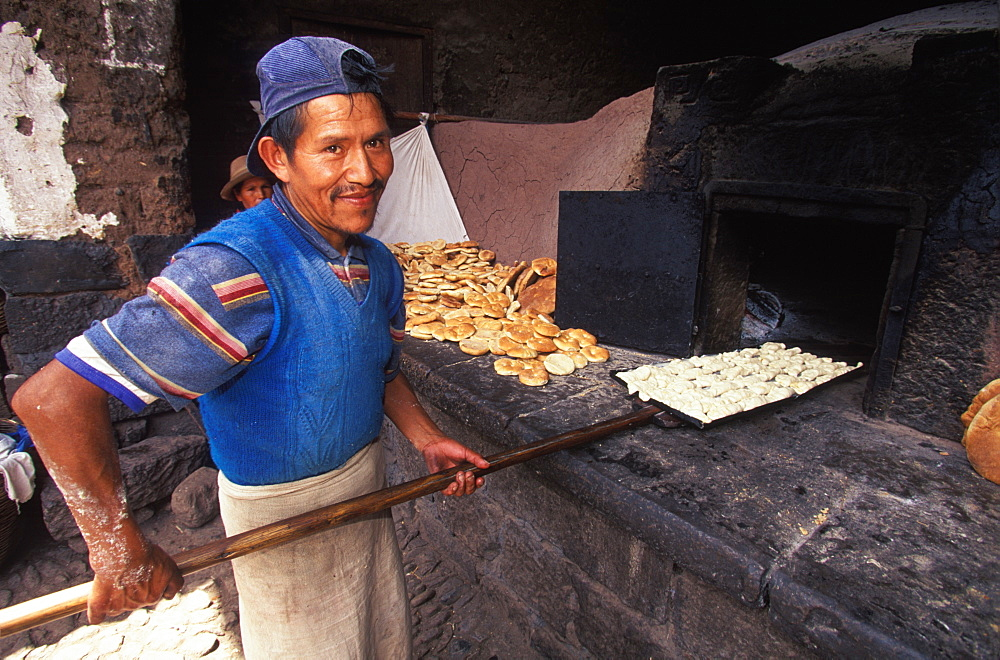 Pisac Village in the Valley of the Incas Sunday Market, one of the world's most colorful markets village baker, Cuzco area, Highlands, Peru