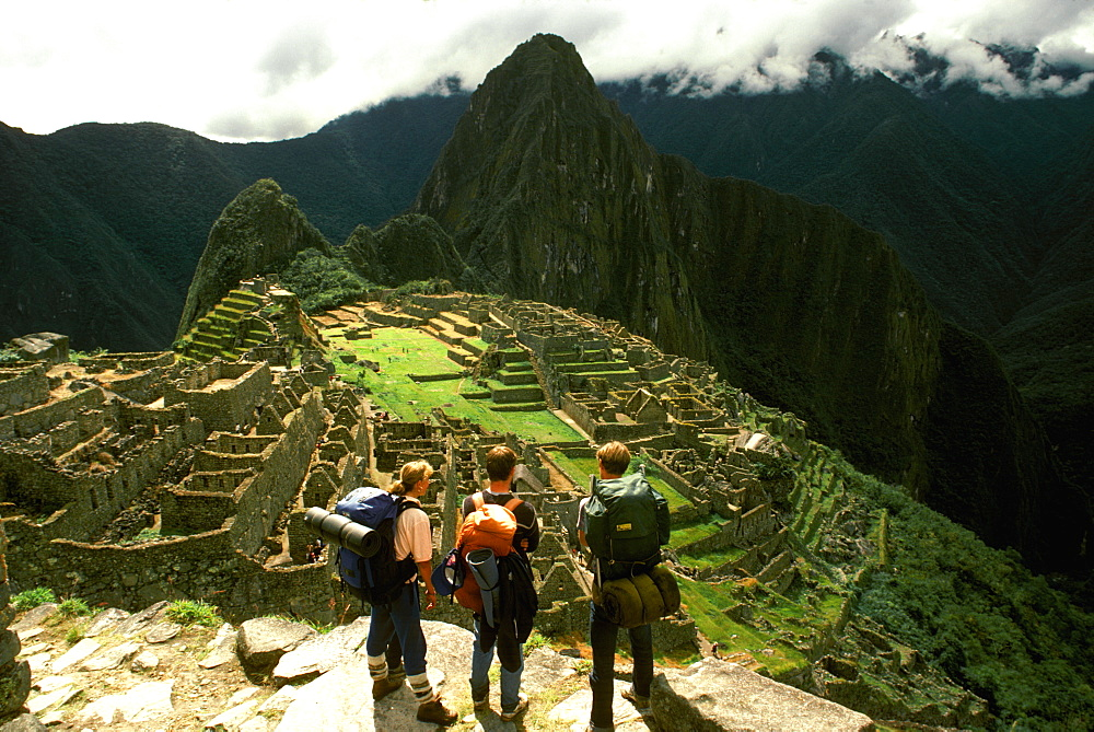 Machu Picchu view of the ancient city with Huayna Picchu Peak above the Rio Urubamba hikers viewing the site from Inca trail, Highlands, Peru