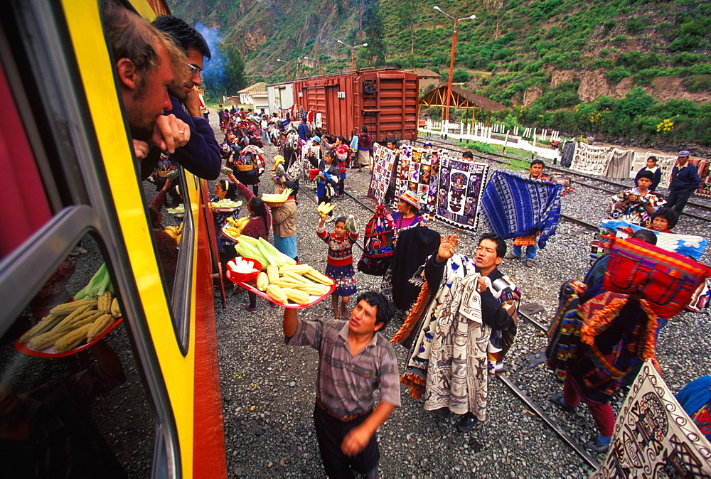 One of the world's most famous train rides thru the Inca Sacred Valley between Cuzco and Machu Picchu vendors and passengers, Peru