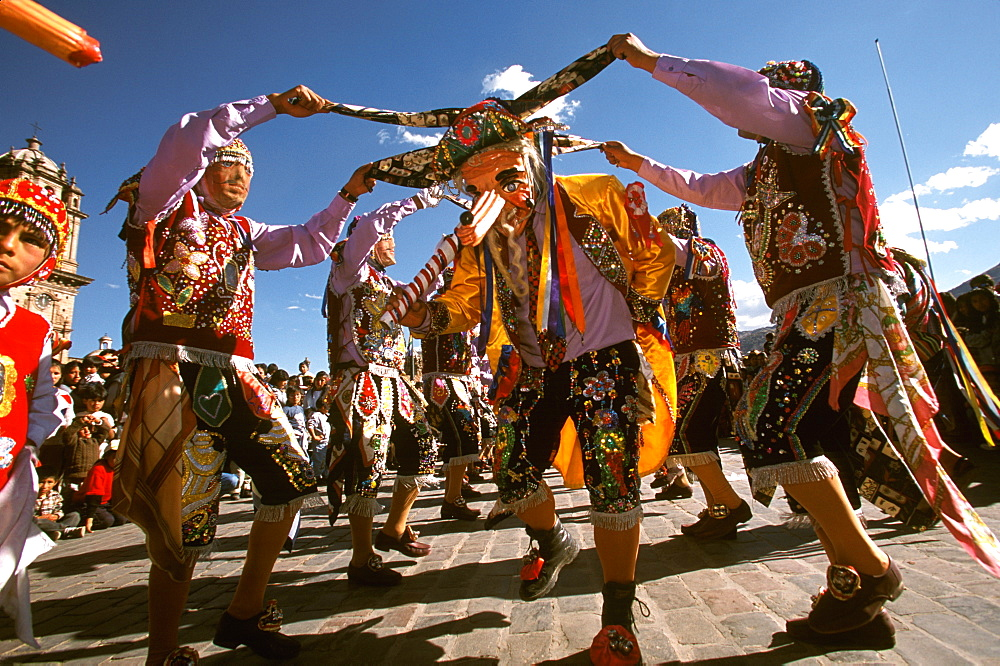 Corpus Christi is one of Peru's most famous festivals, costumed dancers perform the colonial mestizo Cholo in Plaza de Armas, Cuzco, Peru