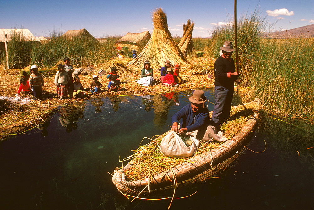 Floating islands of the Uros near Puno an ancient culture, noted for making traditional boats of woven totora reeds, Lake Titicaca, Peru