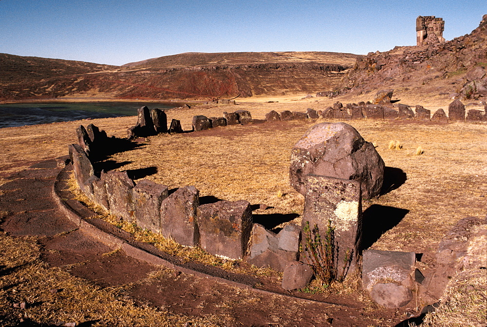 Aymara Culture 1000AD, pre-Inca observatories at Sillustani near Puno, chullpa tombs on hillside beyond, Lake Titicaca, Peru