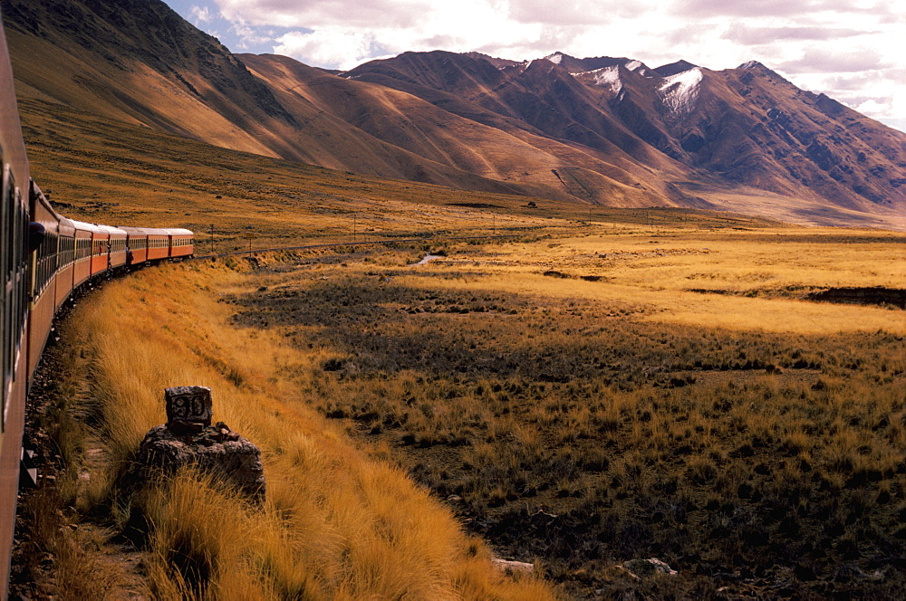 The famous railroad that climbs from Cuzco at 11,000 to Puno at 14,000 on Lake Titicaca, Altiplano, Peru