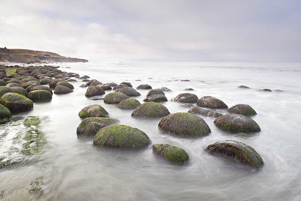 Boulders, known as Bowling Ballls, in the surf, Bowling Ball Beach, California, United States of America, North America