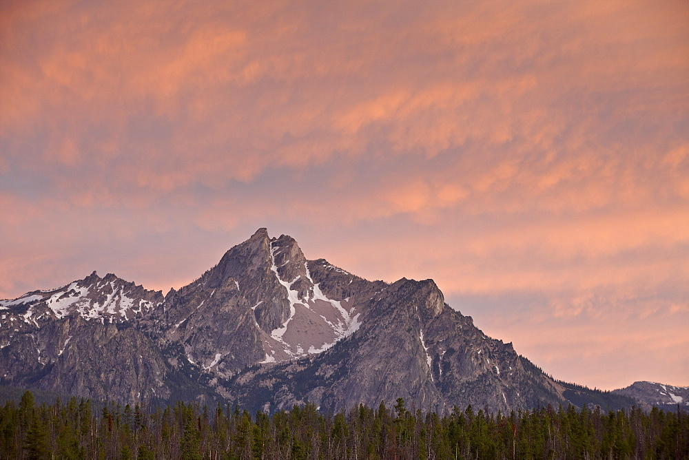 Orange clouds over McGowen Peak at sunset, Sawtooth National Recreation Area, Idaho, United States of America, North America