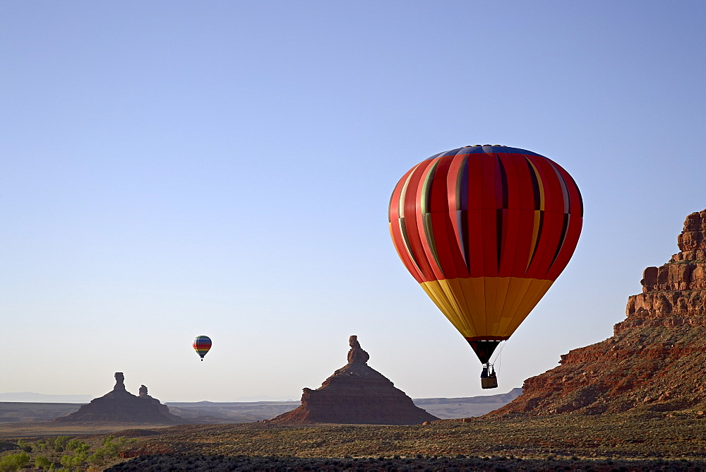 Formations in Valley of the Gods with two hot air balloons, near Mexican Hat, Utah, United States of America, North America