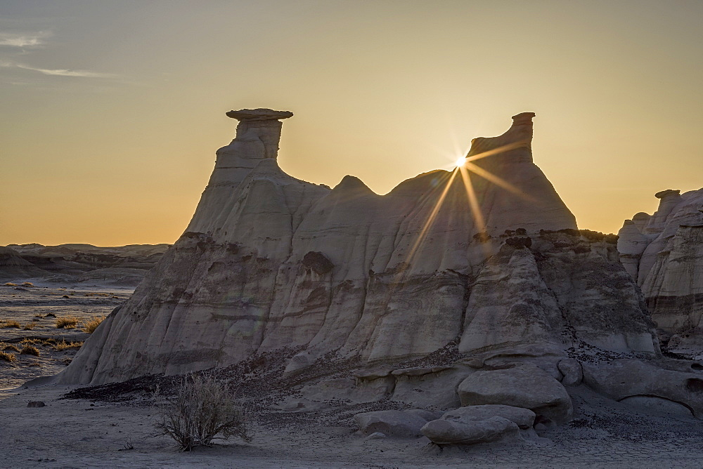 Sunburst behind a rock formation, Bisti Wilderness, New Mexico, United States of America, North America