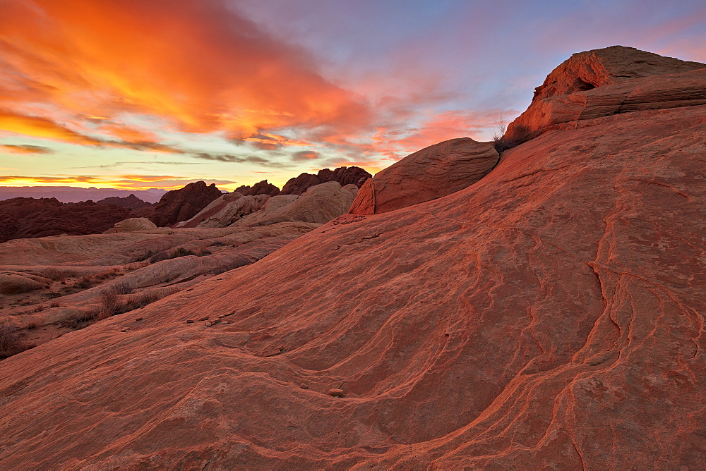 Brilliant orange clouds at sunrise over sandstone, Valley Of Fire State Park, Nevada, United States of America, North America