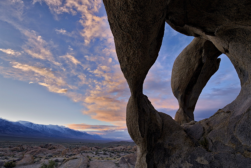 Sunset through Cyclops' Skull Arch, Alabama Hills, Inyo National Forest, California, United States of America, North America