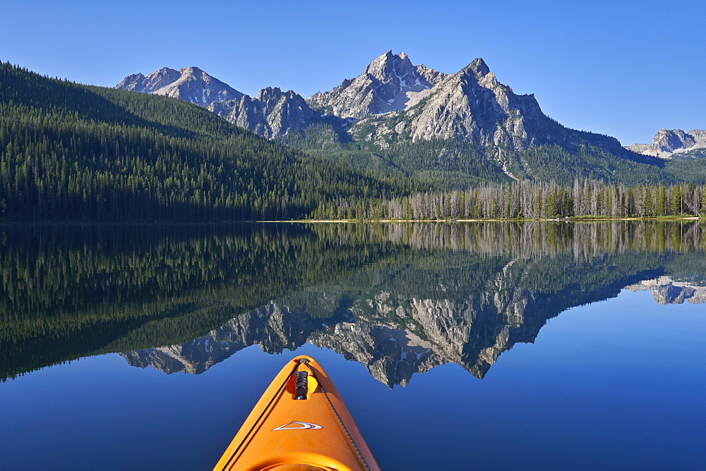 McGown Peak reflected in Stanley Lake while kayaking, Sawtooth National Recreation Area, Idaho, USA
