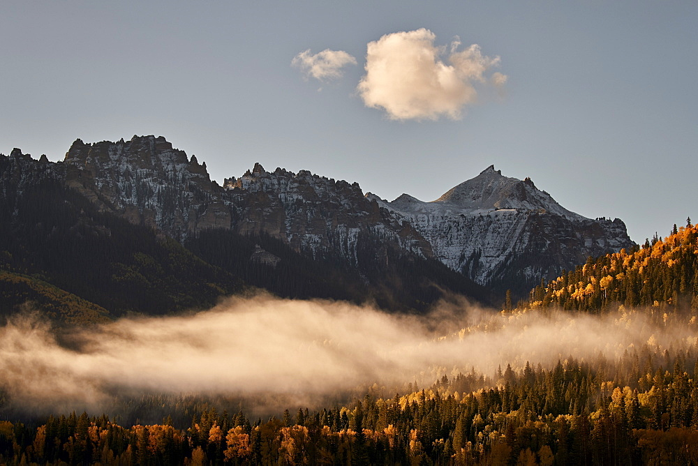 Snow-covered mountain in the fall with fog, Uncompahgre National Forest, Colorado, USA
