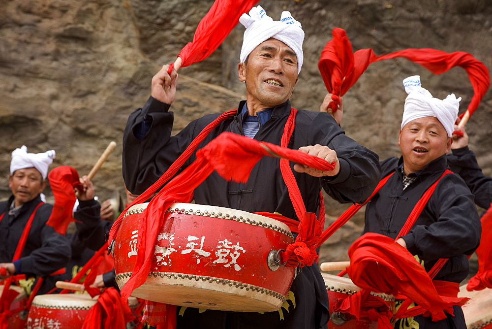 Waist Drum performance at Hukou Waterfall on the Yellow River in Shaanxi Province, China, Asia