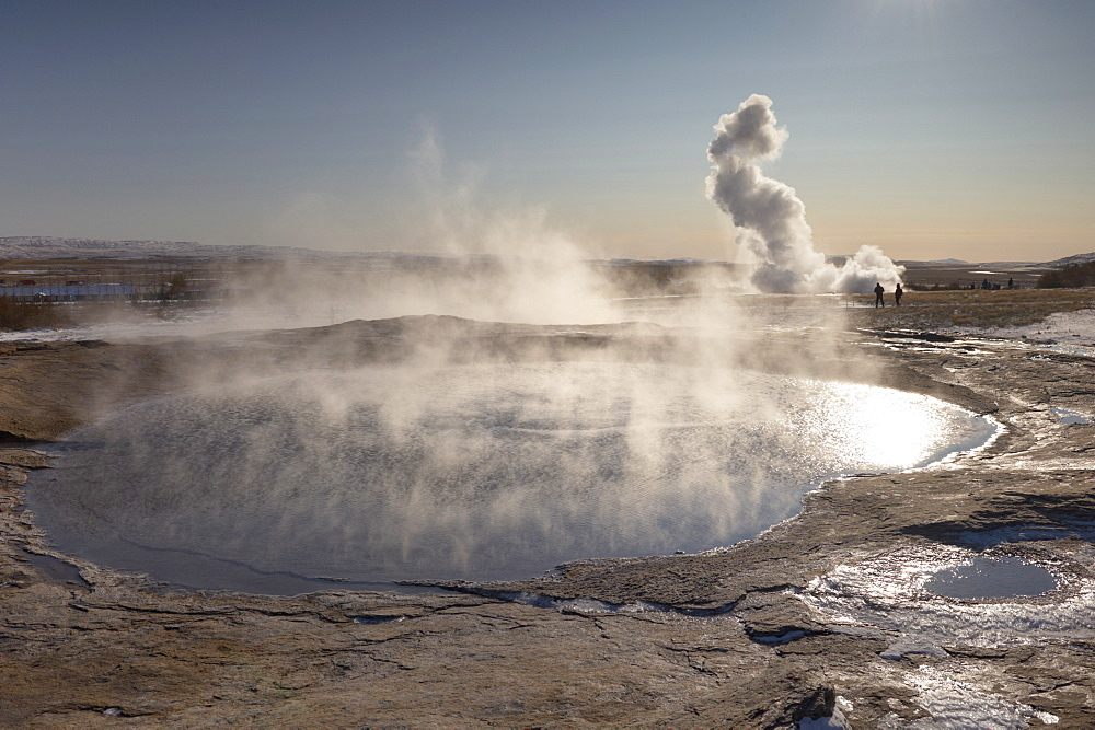 The great geyser Geysir, now dormant (2008), with the more active Strokkur geyser erupting in the distance, Geysir, Haukadalur valley, Golden Circle, Iceland, Polar Regions