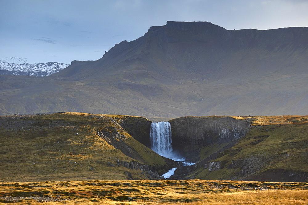 Waterfall in Snaefellsjokull National Park, Snaefellsjokull behind, covered in clouds, near Hellisandur, Snaefellsnes Peninsula, Iceland, Polar Regions