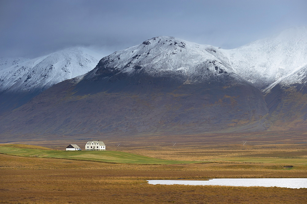 Laekjamdt farm, snow-covered Vididalsfjall mountain behind, near Blonduos, north coast, Iceland, Polar Regions - 770-1234