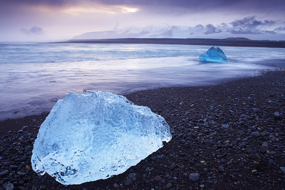 Iceberg washed ashore on Breidamerkursandur black sands, near Jokulsarlon glacial lagoon, East Iceland, Polar Regions - 770-1343