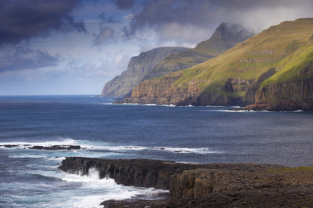 Sea cliffs and surf near Famjin (Logvatangi, Brimnestangi), on Suduroy west coast, Suduroy Island, Faroe Islands (Faroes), Denmark, Europe