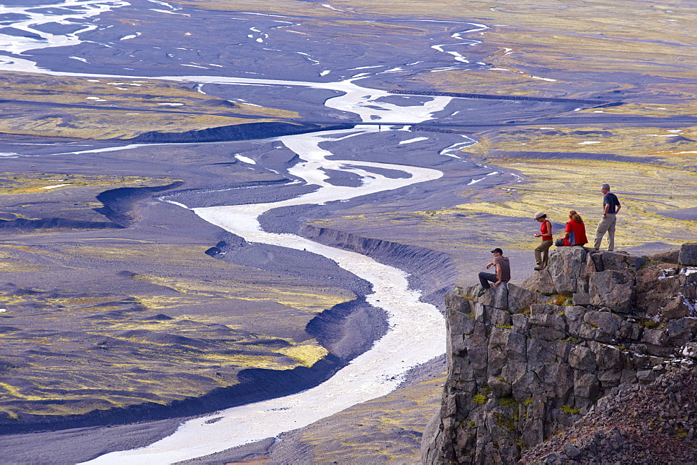 Hikers taking a rest above the Skaftafellsjokull glacier, Skaftafellsa glacial river in the background, in Skaftafell National Park, south-east Iceland (Austurland), Iceland, Polar Regions - 770-1680