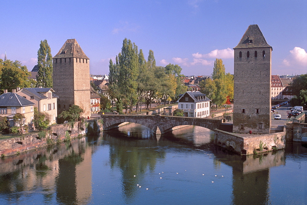 The Ponts-couverts (Covered-bridges) dating from the 14th century and two defensive towers over River Ill, overlooking the Petite France quarter, part of the Grande Ile, UNESCO World Heritage Site, Strasbourg, Alsace, France, Europe - 770-1718
