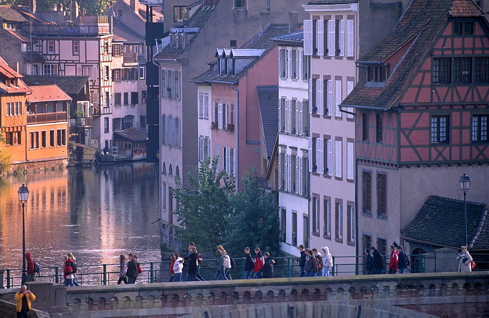 Pedestrians on the Ponts-couverts (Covered-bridges) over the River Ill, overlooking the Petite France quarter, Grande Ile, UNESCO World Heritage Site, Strasbourg, Alsace, France, Europe - 770-1719
