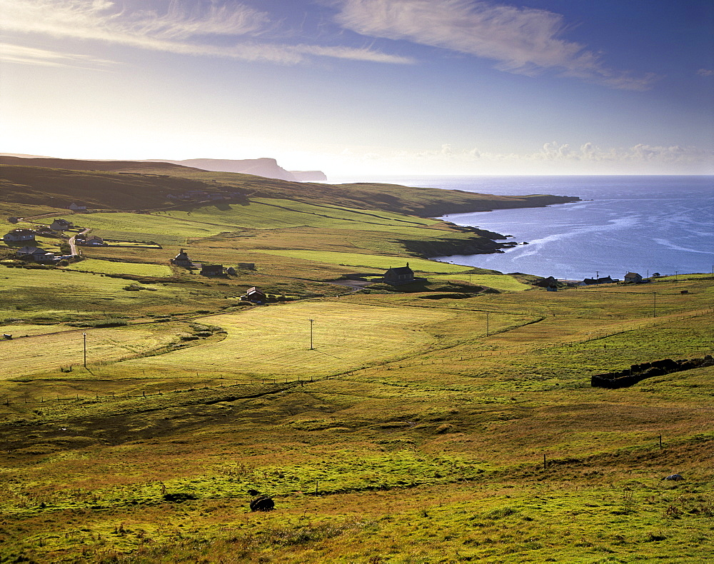 View of Trebister (Gulberwick) and Trebister Ness, south of Lerwick in a morning light, Bressay visible in the distance and The Ord cliffs and Bard Head, Mainland, Shetland Islands, Scotland, United Kingdom, Europe