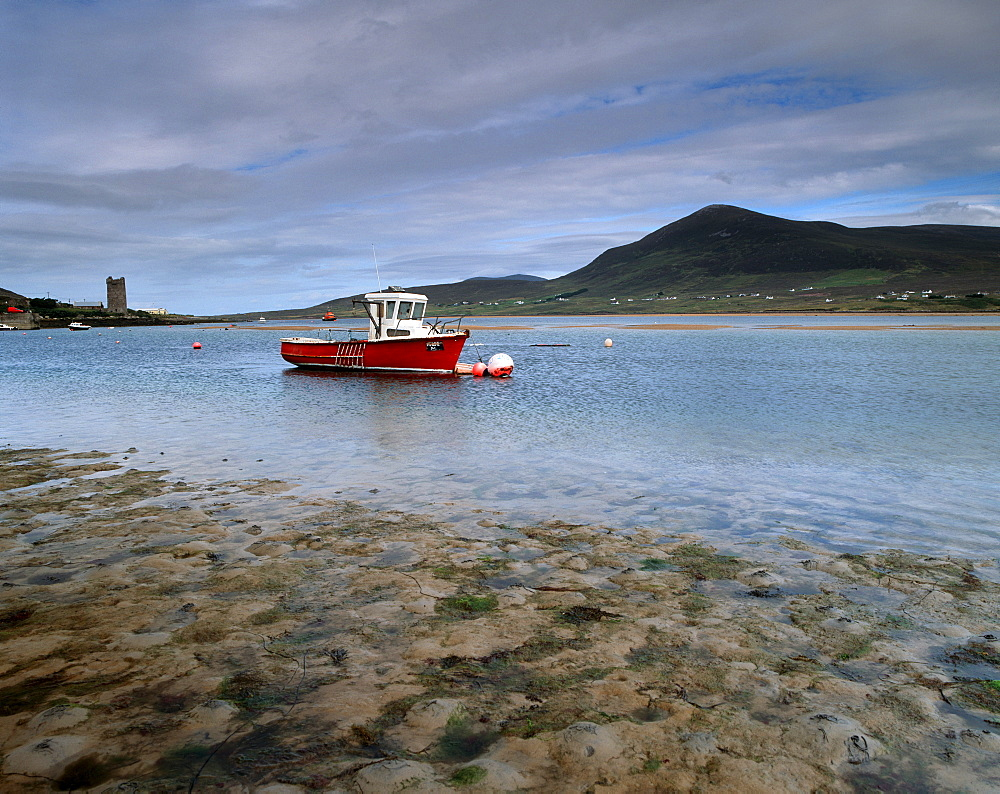 Red boat in Achill Sound at low tide, Achill Island, County Mayo, Connacht, Republic of Ireland, Europe