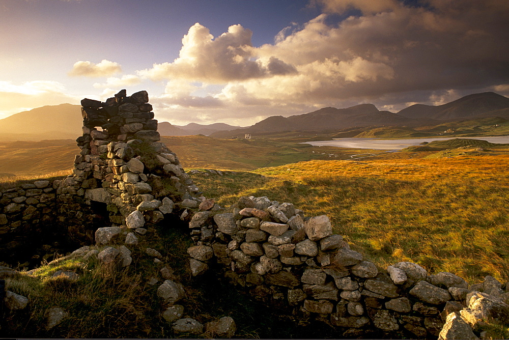 Old blackhouse ruin near Timsgarry (Timsgearraidh), west coast, sunset. Isle of Lewis, Outer Hebrides, Scotland, United Kingdom, Europe - 770-687