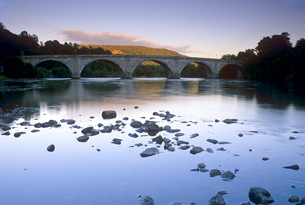 The seven-arched Dunkeld Bridge over the River Tay at dusk, built by Thomas Telford, Dunkeld, Perth and Kinross, Scotland, United Kingdom, Europe