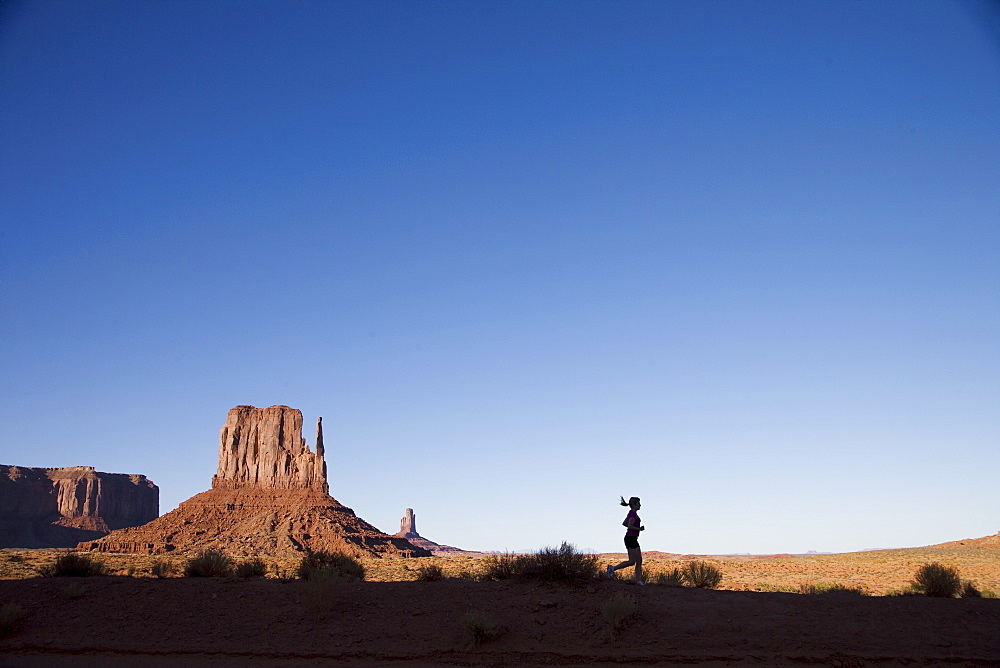 Woman jogging, Monument Valley Navajo Tribal Park, Utah Arizona border, United States of America, North America