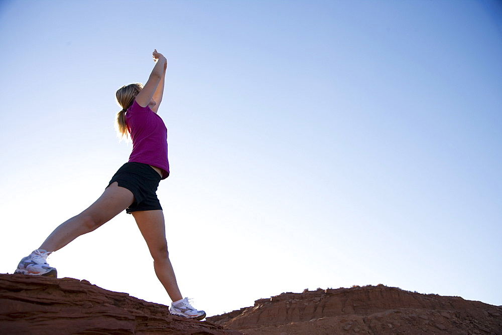 Woman exercising, Monument Valley Navajo Tribal Park, Utah Arizona border, United States of America, North America