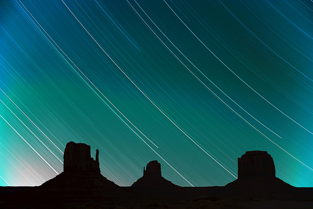 Long exposure of star trails in night sky, Monument Valley Navajo Tribal Park, Arizona Utah border, United States of America, North America